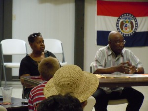Charles Alexander speaks about family lineage (Virginia Lawrence looks on).